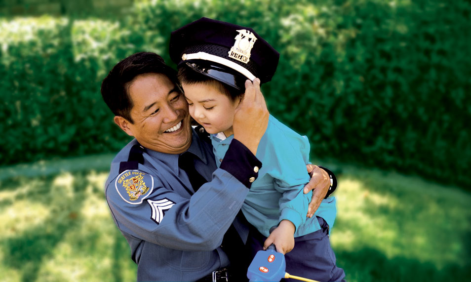 Seattle Police Department's Randy Yamanaka with Luke Do in 2006. Yamanaka saved Do's life through a bone marrow donation. (Photo provided by Seattle Police Department)