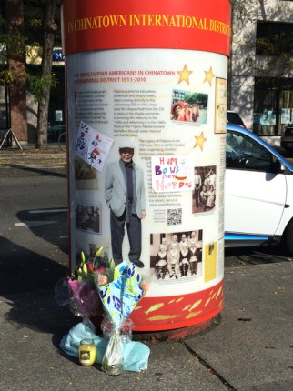Mourners placed flowers at an ID kiosk about Filipino history (Photo by Assunta Ng/NWAW)