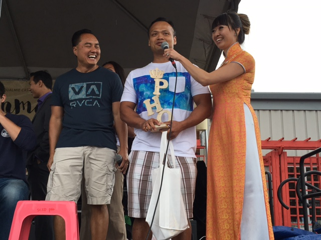 Pho Challenge winner Michael Truong with sponsor Thach Nguyen (left), and emcee Juliet Dang. (Photo by John Liu/NWAW)