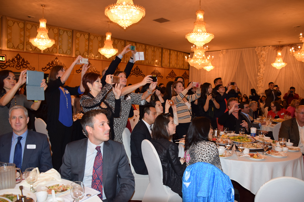 Guests had their tablets and phones out when the honorees congregated on stage for a group photo.