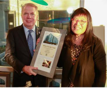 Mayor Ed Murray (left) with LIHI Executive Director Sharon Lee. (Photo by Steve Rowland)
