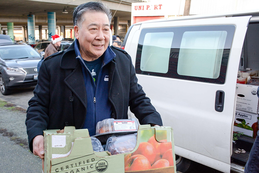 Jerry Lee carries a box of perishables to donate to the ACRS Food Bank. (Photo from ACRS)