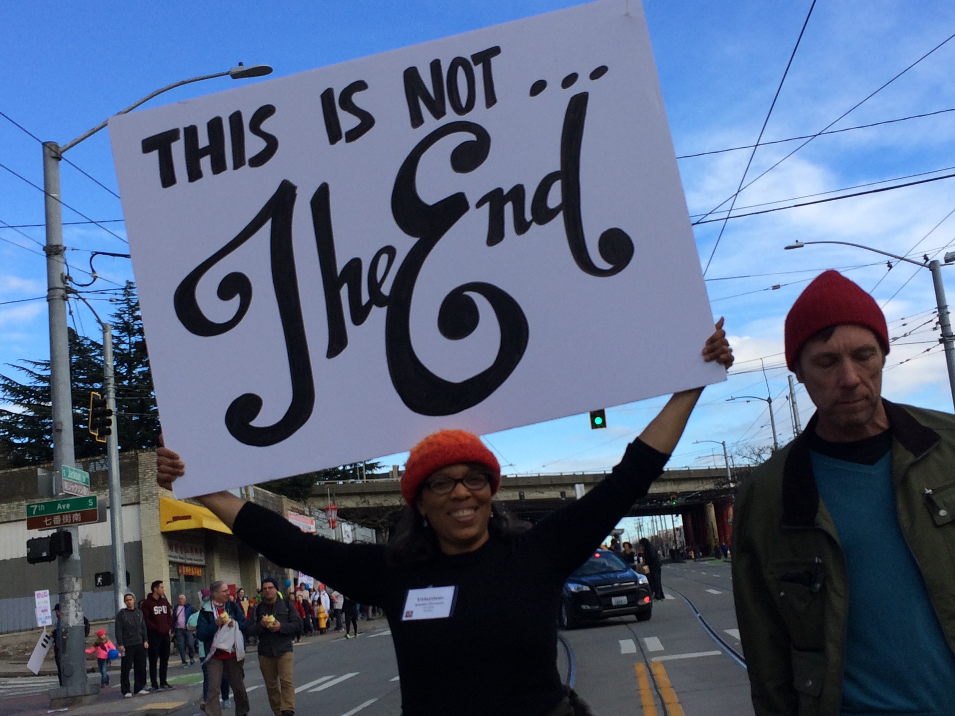 Lisa Price, a member of the planning committee, holding a sign at the end of the march. (Photo by Assunta Ng/NWAW)