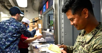 Seattle sailor delivers the mail aboard USS Blue Ridge