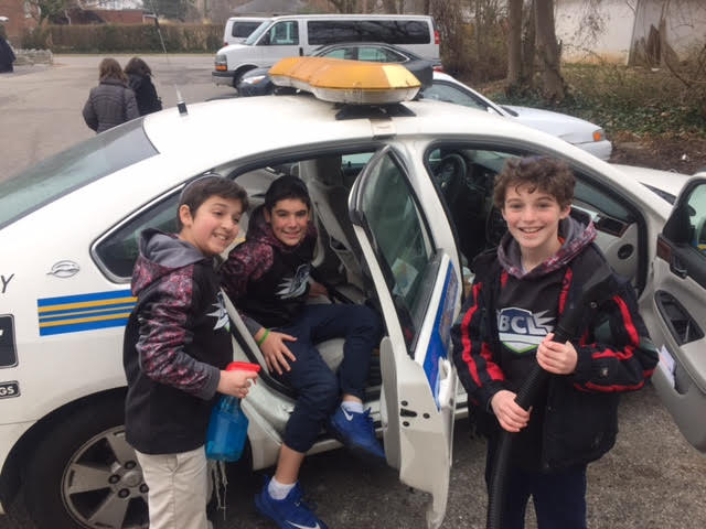Kids from the community helping clean the NWCP Patrol car for Pesach