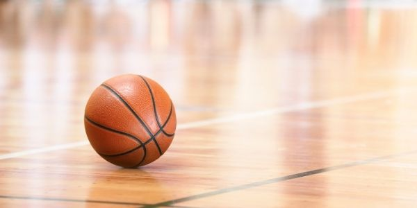 Photo of basketball on gym floor