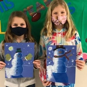 students working on snowman art