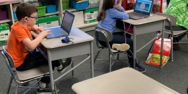 students listening to computer