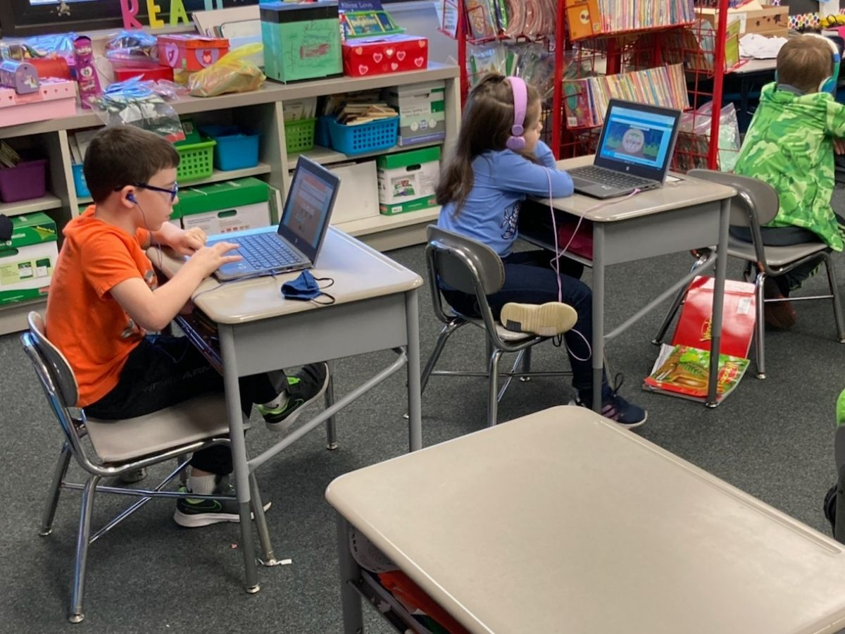 students at desks on computers