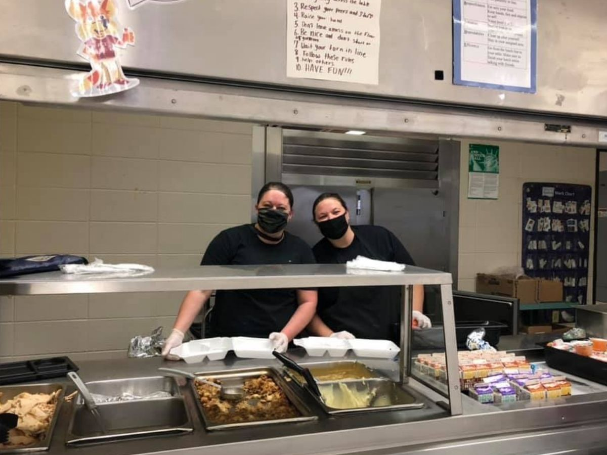 cafeteria workers smiling behind masks