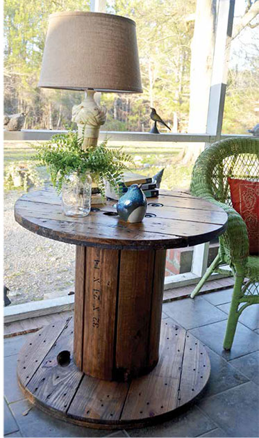 Spool table finished with lamp and accessories.
