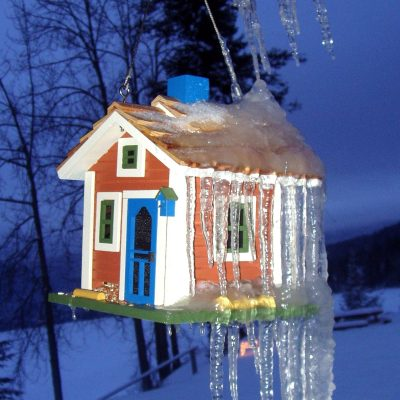 a birdhouse covered in icicles