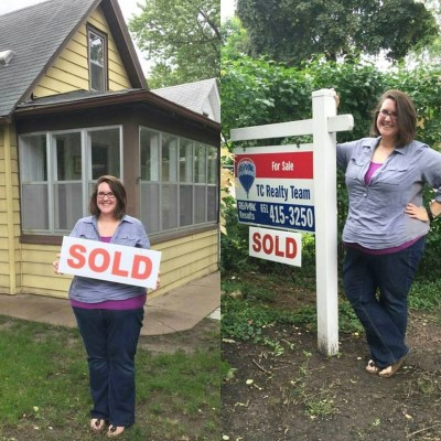 a homebuyer stands in front of her new home