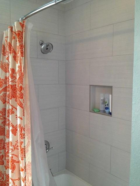 I really like that orange shower curtain!