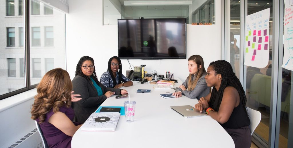 Five women in a business meeting