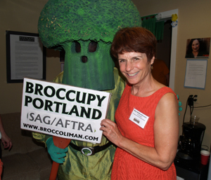 Portland's  SAG-AFTRAoffice closed May 31, though not without a sendoff party. Above, national union board member Mary McDonald-Lewis greets friends, like Broccoliman, who dropped by to say farewell.