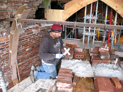 Local 1 member Cameron Orvin restores brick arches inside the furnace to look identical to their original construction.