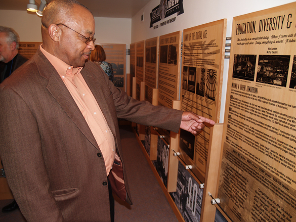 Keith Edwards, a 44-year member of IBEWLocal 48, checks out an exhibit  at the Oregon Historical Society featuring the 100th anniversary partnership of NECA/IBEW. Edwards,  the first black business manager of an IBEWlocal in the nation, retired in December as an international rep.