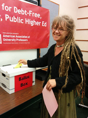 Casting a ballot for the contract. (Photo courtesy PSU-AAUP)