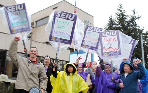 """Members of SEIU Local 49 picket outside McKenzie-Willamette Hospital April 17 to protest extreme stalling in contract negotiations. The National Labor Relations Board has ruled that the for-profit hospital chain's """"bad-faith bargaining"""" violates federal labor law."""