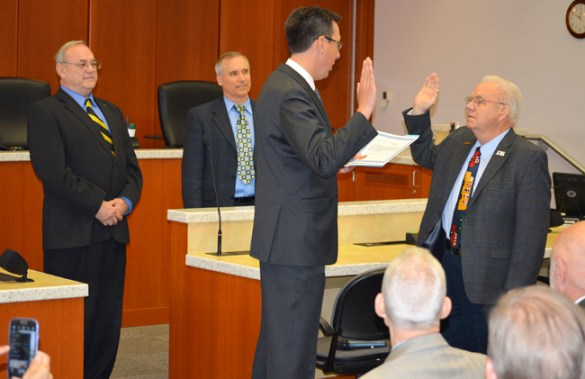Ed Barnes (right) is sworn in June 10 as a Clark County commissioner by Vancouver Prosecuting Attorney Tony Golik. Standing to the left is Commissioner David Madore.