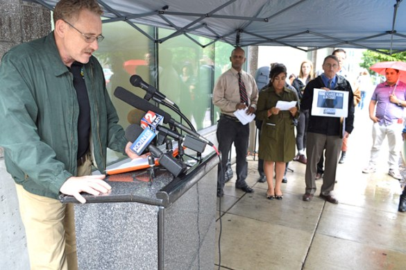 Tom Chamberlain, president of the Oregon AFL-CIO, joins with immigrant and community groups at a press conference outside the federal Immigration and Customs Enforcement (ICE) field office in Northwest Portland, where the organizations called on President Barack Obama to use his executive powers to implement comprehensive immigration reform.