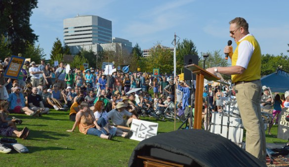 """A LABOR VOICE FOR ACTION ON CLIMATE CHANGE. On stage in Portland's Waterfront Park, Oregon AFL-CIO President Tom Chamberlain brought a labor union perspective to the Sept. 21 Portland People's Climate march. """"We are brothers and sisters, joined together by common values, believers in scientific data and a faith that we can create a better world,"""" Chamberlain declared. """"That commitment and determination must begin today at an earth-shaking pace."""""""