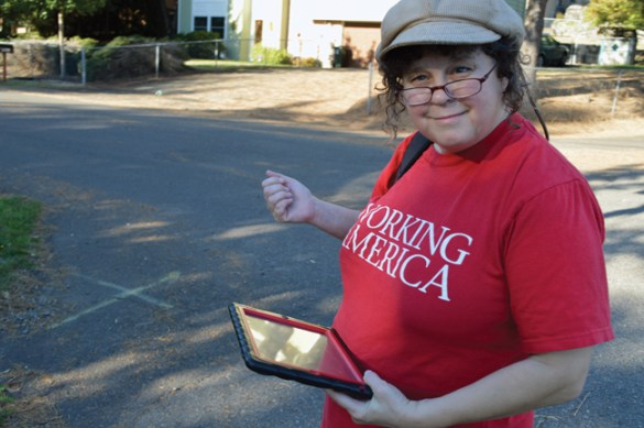 Working America canvasser Chellema Qolus, with tablet, in Gladstone