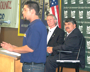 AFL-CIO President Rich Trumka (right) and gubernatorial candidate John Kitzhaber listen to Nick Gaitaud of Steelworkers Local 7150 at an Aug. 23 gathering in Portland