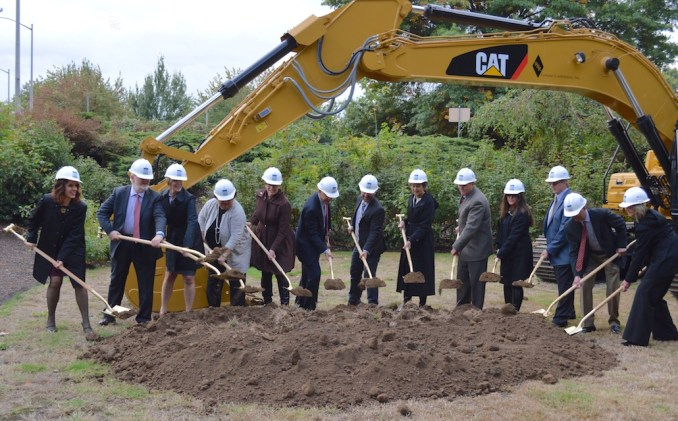 HEELS ON A CONSTRUCTION SITE? MAYBE JUST THIS ONCE. Dignitaries who made the courthouse project possible, starting with County Chair Deb Kafoury (left) line up to shovel ceremonial first dirt.