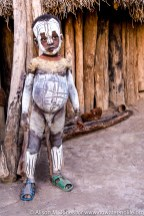 Ethiopia: Lower Omo River Basin, Lebuk, a Karo village, during dancing ceremony, portrait of Karo child covered in face paint