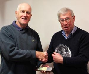 Anthony McGonigle being presented the Silva Trophy by Noel Bogle