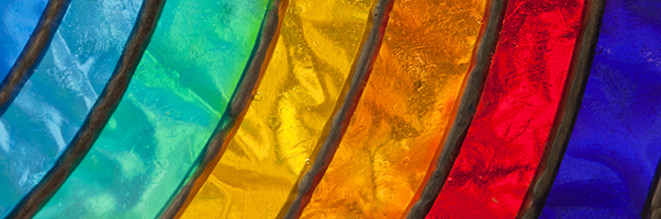 Close up of rainbow-colored stained glass