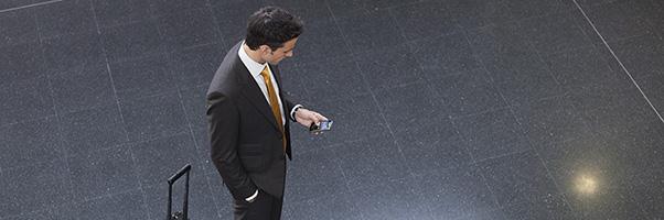 Attorney checking cellphone