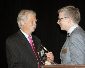 Public Service Award Recipient Kenneth G. Kieffer accepts his award from WSBA President Anthony Gipe.