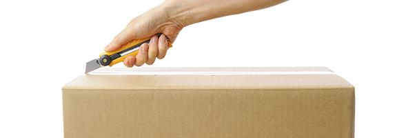 Someone opening a box