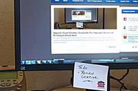 Sticky note reminder on a computer monitor
