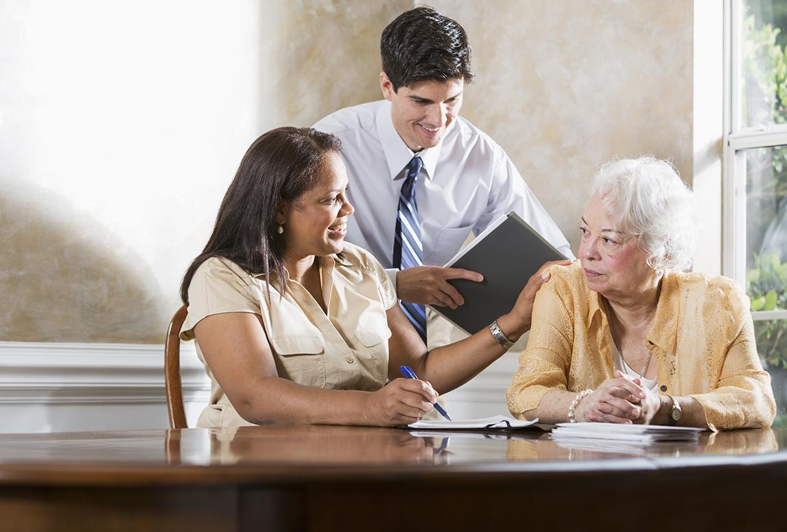 Pro bono attorneys advising a senior woman
