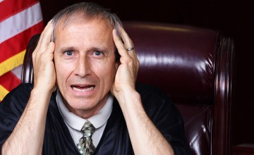 Stressed out judge who looks like Munch's The Scream