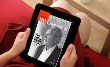 A woman reading NWLawyer on a tablet