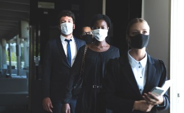 Attorneys entering the office wearing protective face masks due to covid-19