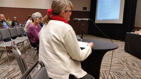 MIRANDA WECKER WAS FRONT AND CENTER AT WDFW'S OCTOBER MEETING IN LYNNWOOD ON WOLVES. (ANDY WALGAMOTT)