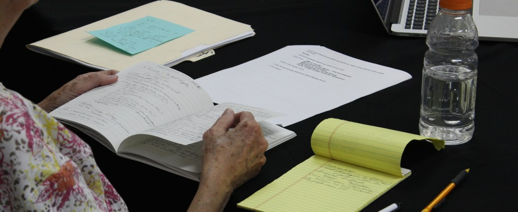 Notes and papers spread out on a table