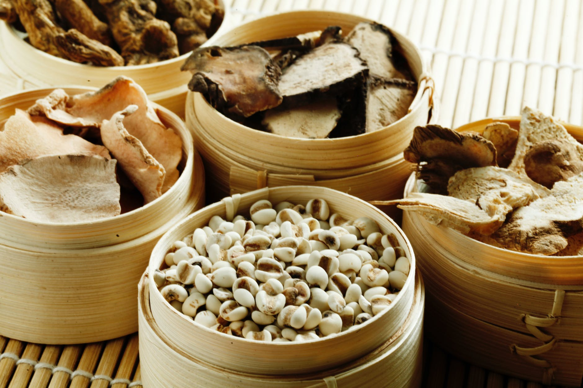 wooden containers with cashew and dried mushrooms