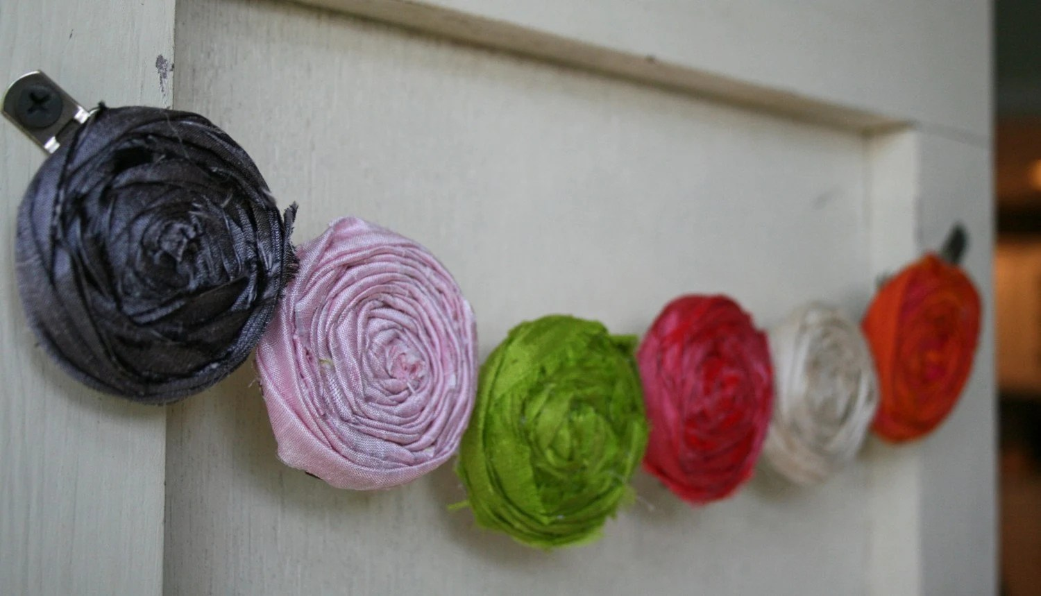 custom boutique to DOT and JUNE couture collection rosette flower posh hair clips...lots of colors to choose from...FREE SHIPPING WHEN PURCHASING MORE THAN ONE..can slip onto headband