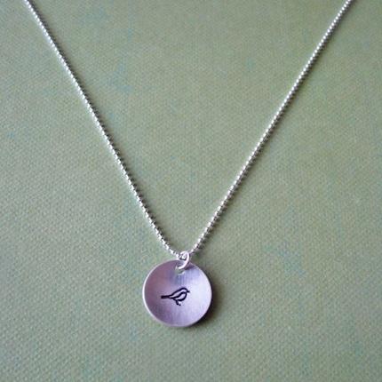 hand stamped silver bird necklace