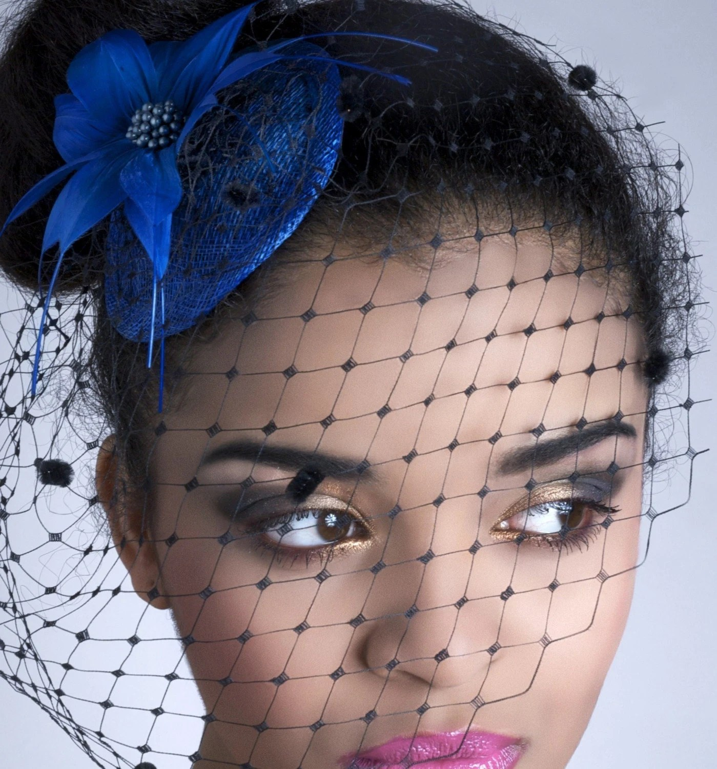 Rome Fascinator - Feather flower headpiece and birdcage veil.