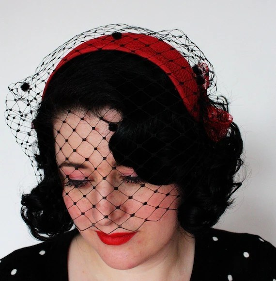 Vintage style fifties half hat in red sinamay with black merry widow veiling