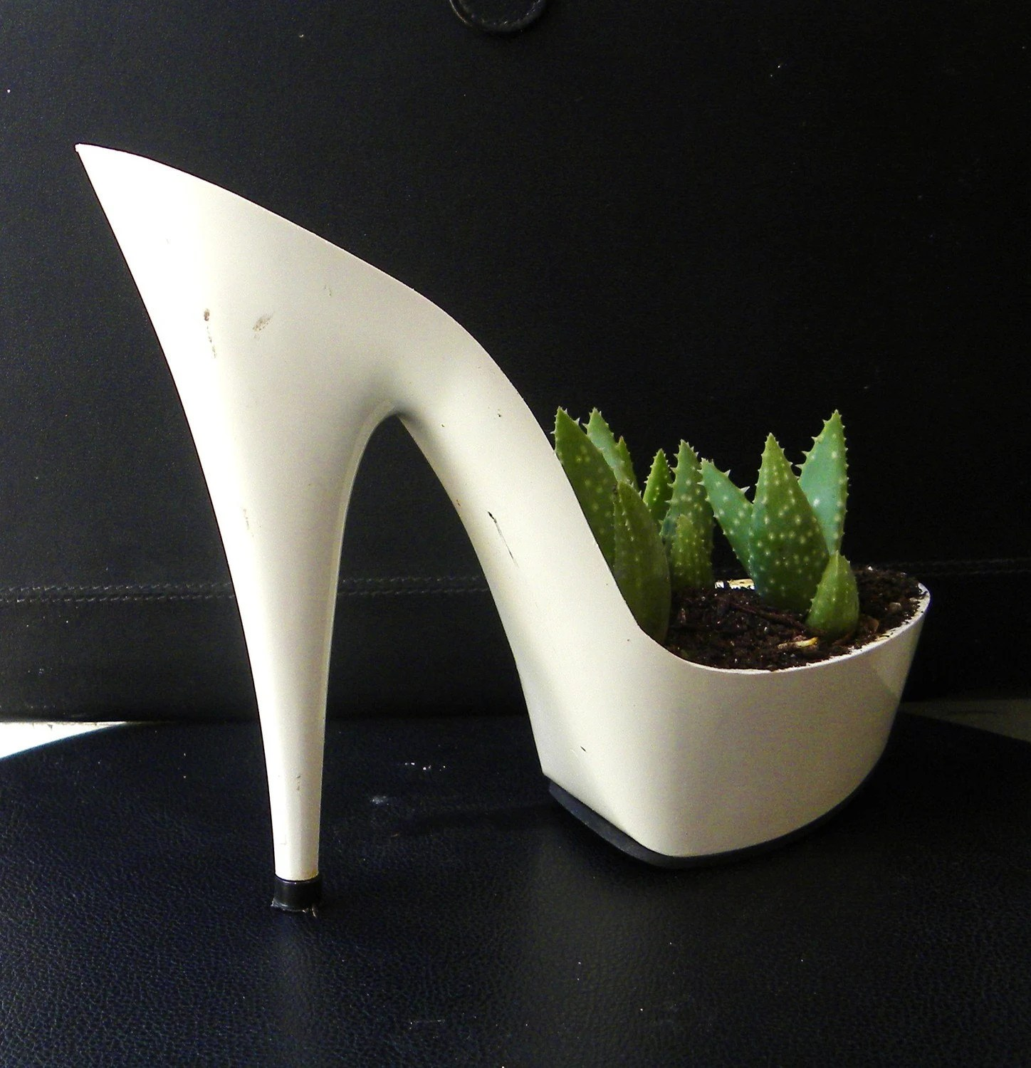 Easy. reclaimed stiletto planter with aloe
