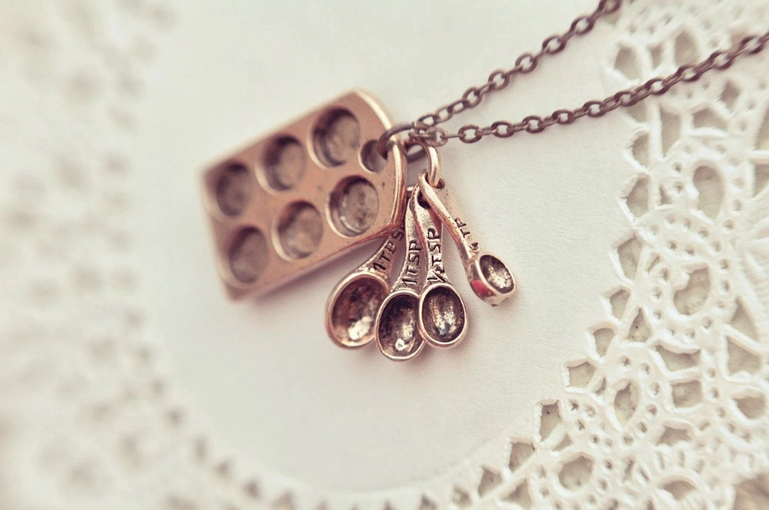 the little baker necklace in antiqued copper.